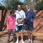Craig Ruane, winner of the 35-39 age group for the 3rd time and winner of the A section, with Mandi Joubert and Blaar Coetzee of the NMSA Committee.